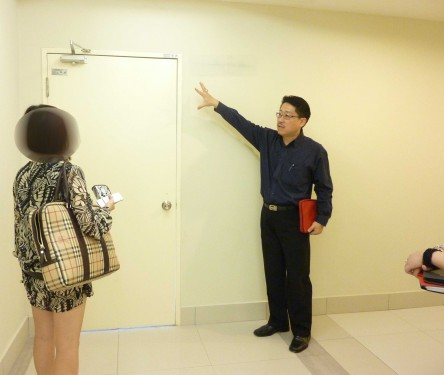 Discussing About The Main Door Direction and Main Door Design and Relocation While The Interior Designer Taking Notes.