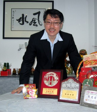"Master Soon With Chinese Caligraphy of ""Feng Shui"" Wishing You A Very Prosperous and Happy New Year of Rabbit 2011."