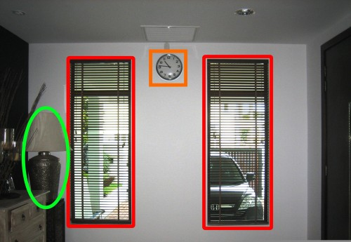 One Wall Clock in the centre of 2 Windows.....